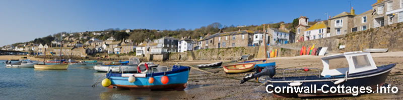 Image of a cornish fishing village with Cornwall Cottages site name